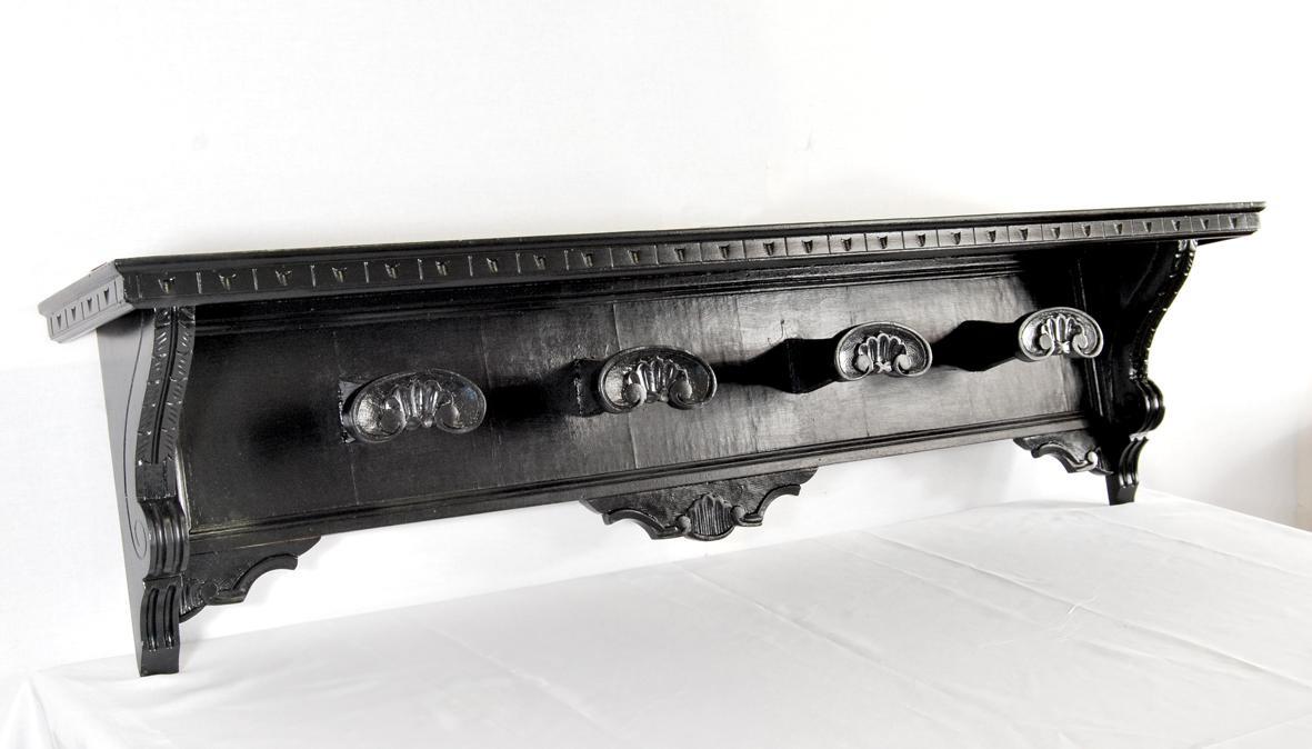 Appendiabiti in legno nero