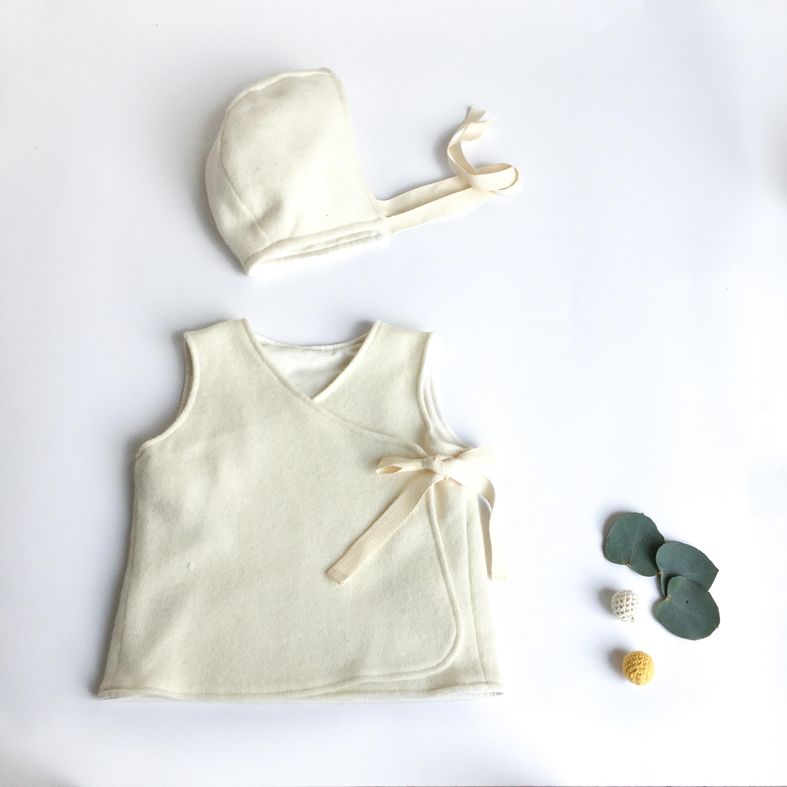 Calottina bianca in cotone biologico e lana