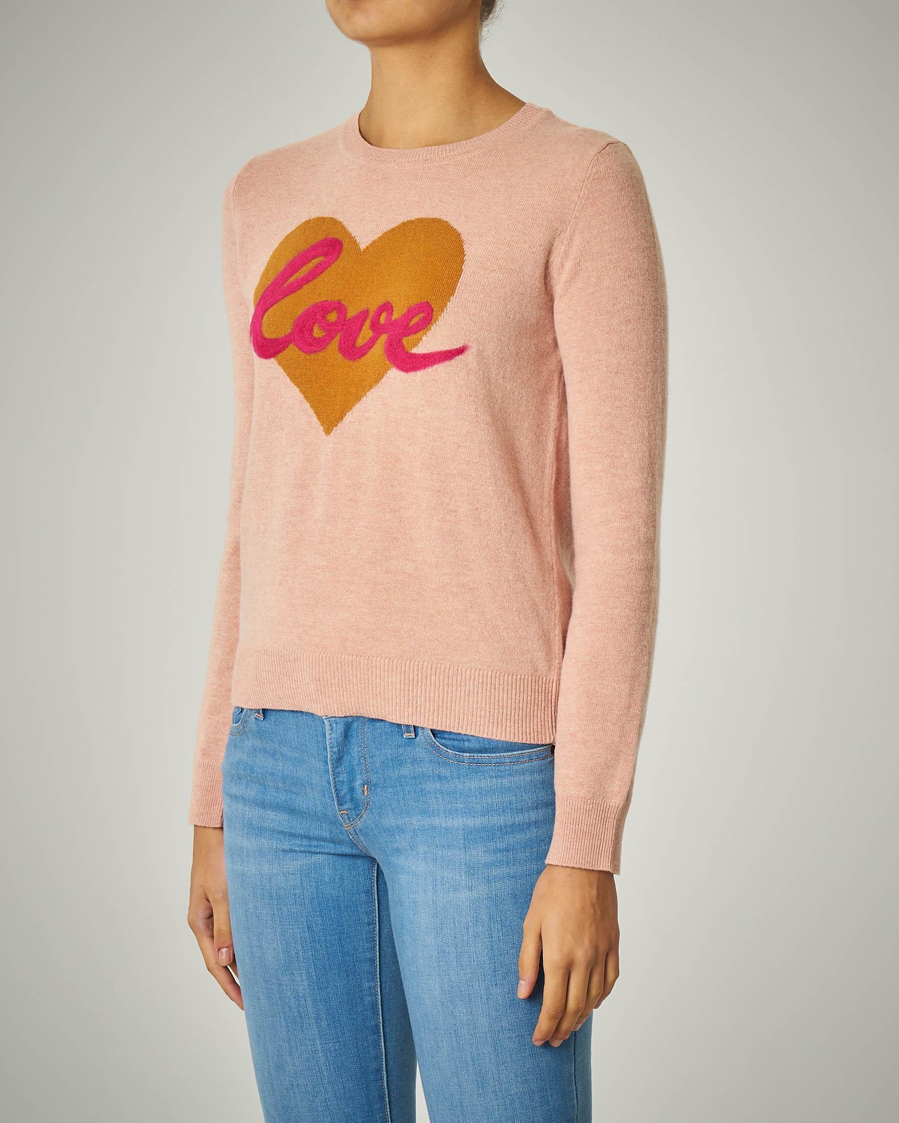 Maglia rosa in lana con ricamo a cuore e scritta