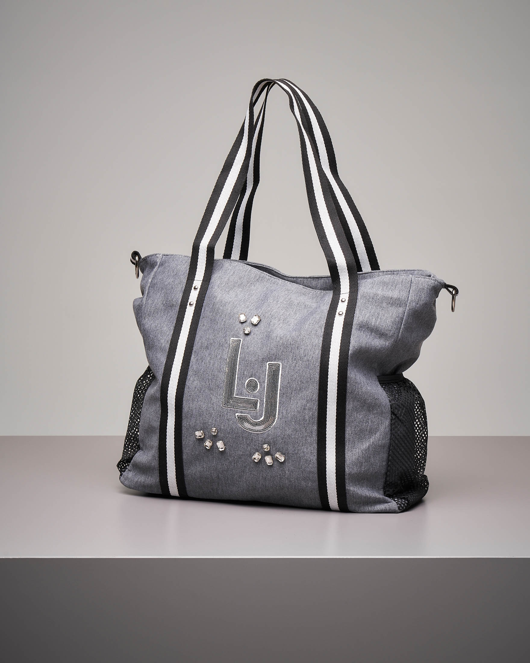 Shopping bag grigia in felpa con logo
