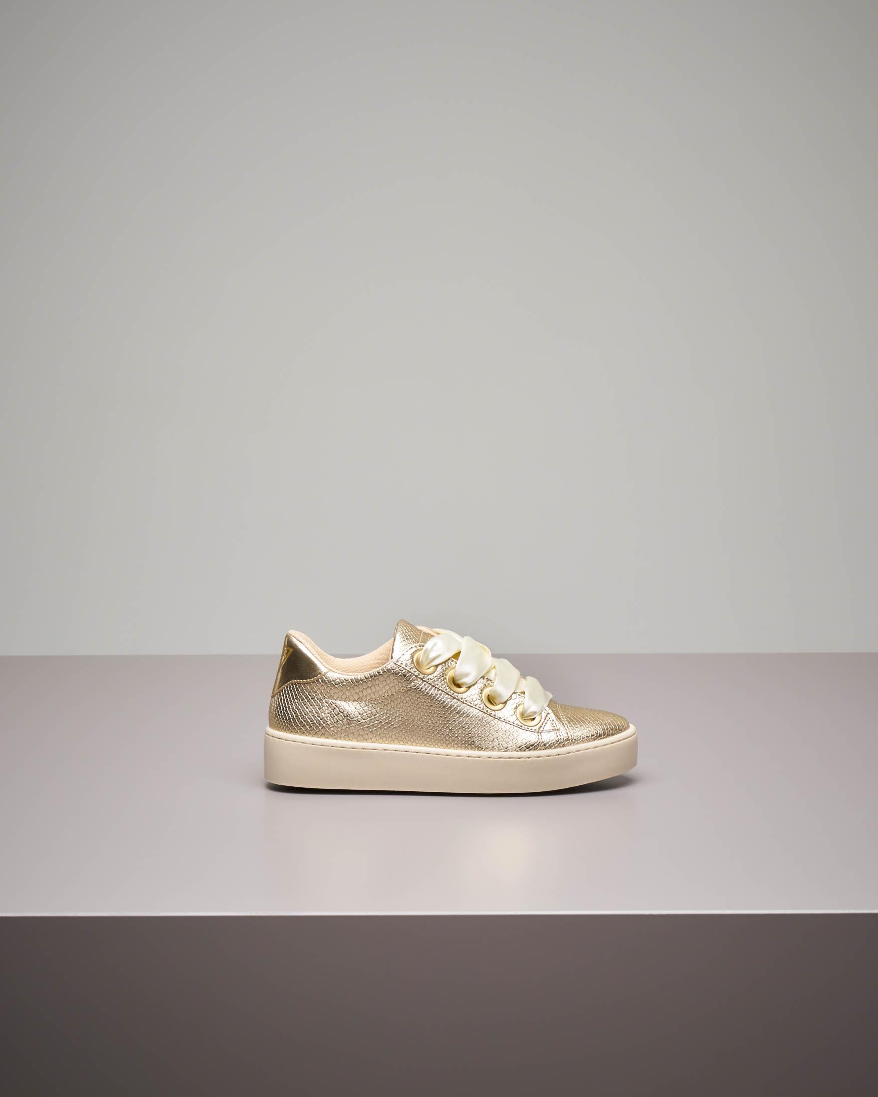 Sneakers oro effetto pitonato