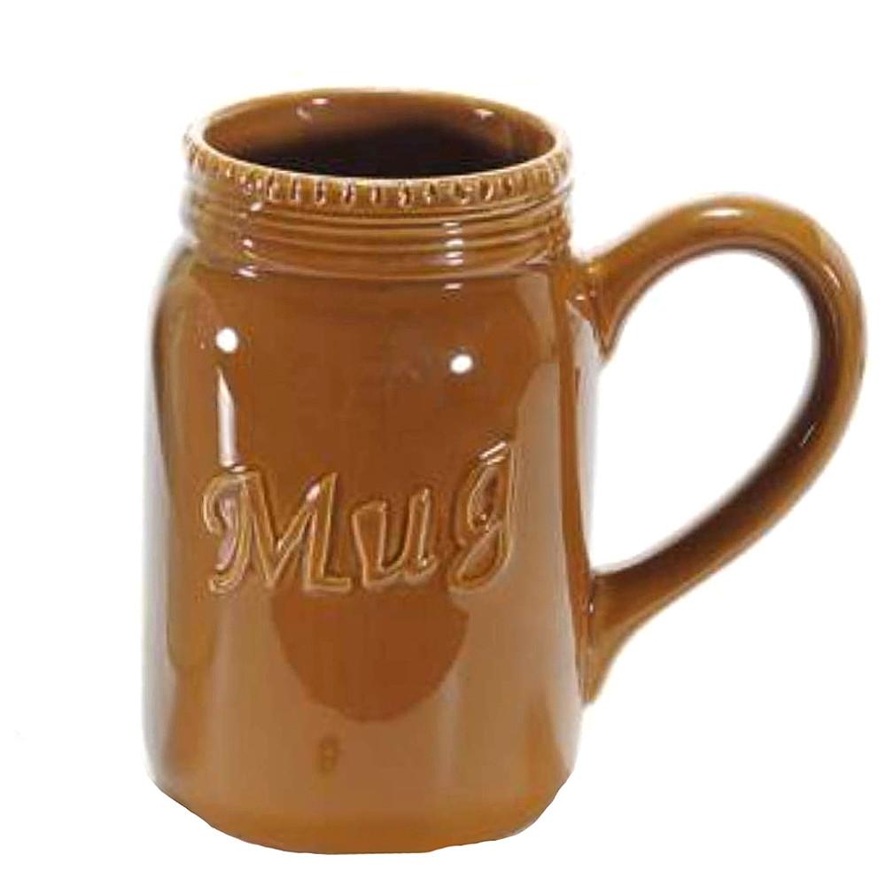 Tazza marrone a forma di boccale in ceramica