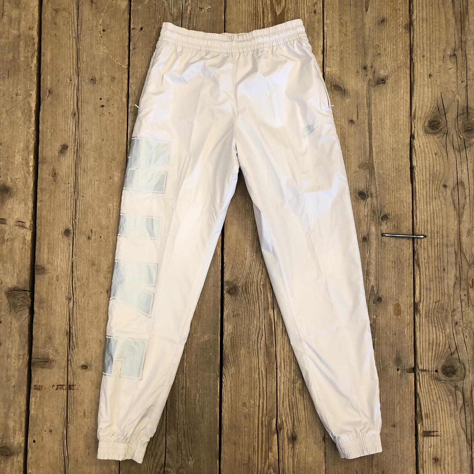 Pantalone Nike in Tessuto Woven Panna/Argento