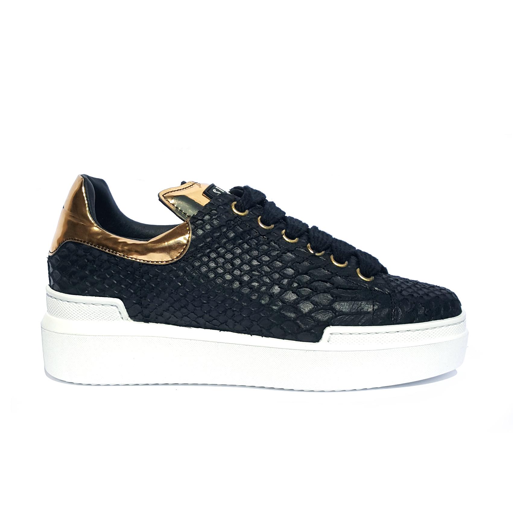 Sneaker nera/oro effetto pitone Stau