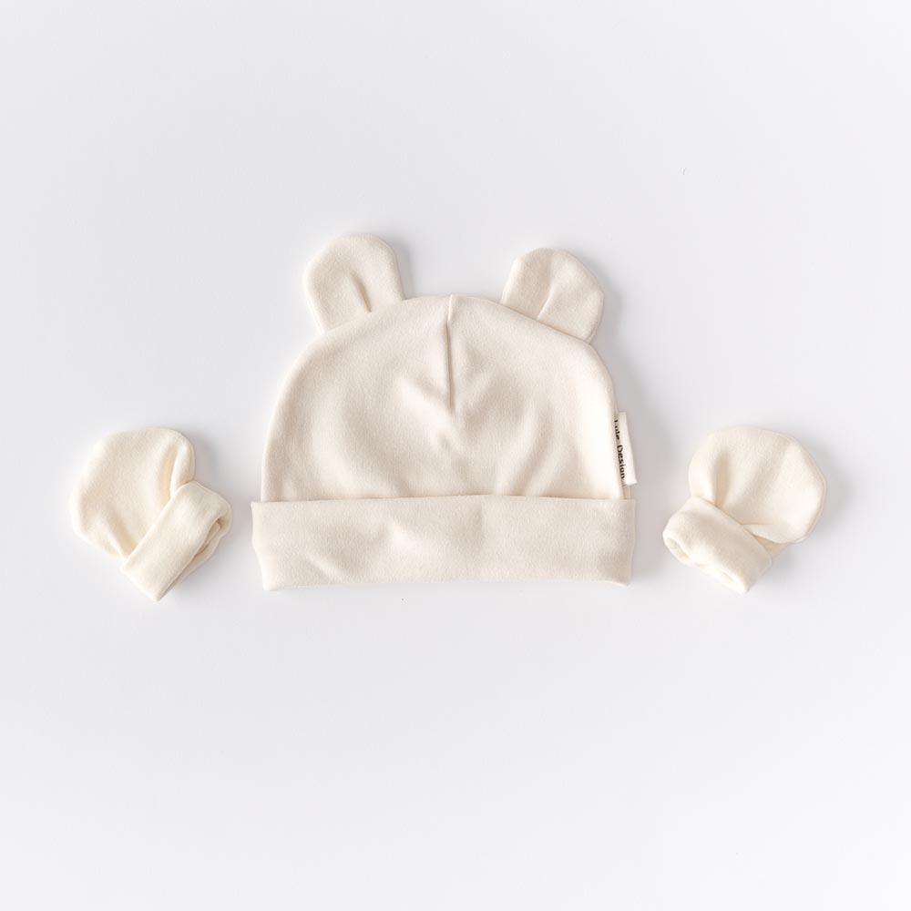 Cappellino color panna con orecchie  in cotone biologico