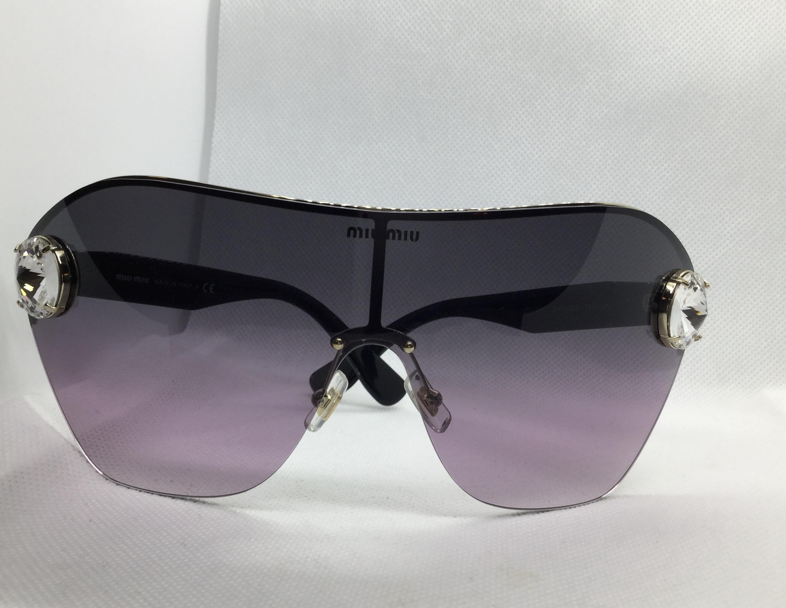 Occhiale sole Donna Miu Miu modello SMU 66U