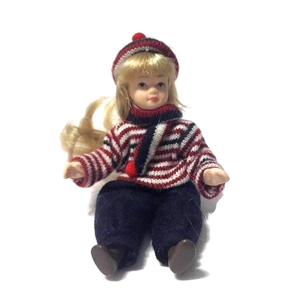 Bambolina di porcellana con pantaloni di velluto