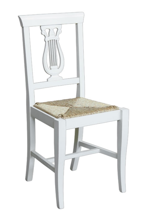 Dining chair with carved backrest
