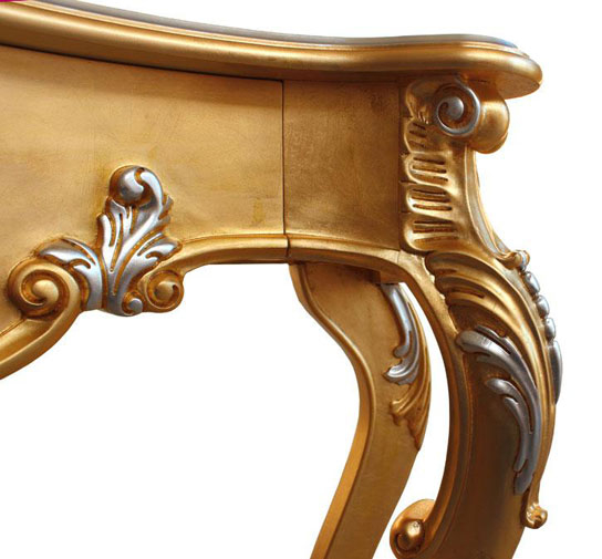 Detail of a console table in golden leaf finish and with silver leaf patina finish details