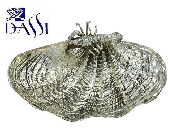 Ciotola in argento in argento 800 a forma di conchiglia. Dimensioni 14.5 x 9.5 cm Alta 4 cm Peso 94 gr