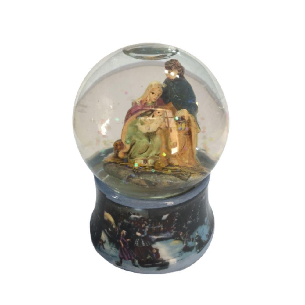 Sfera natalizia di neve in vetro con presepe natività