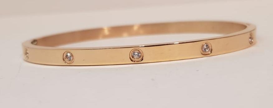 bracciale acciaio gold rose manettta 10 zirconi