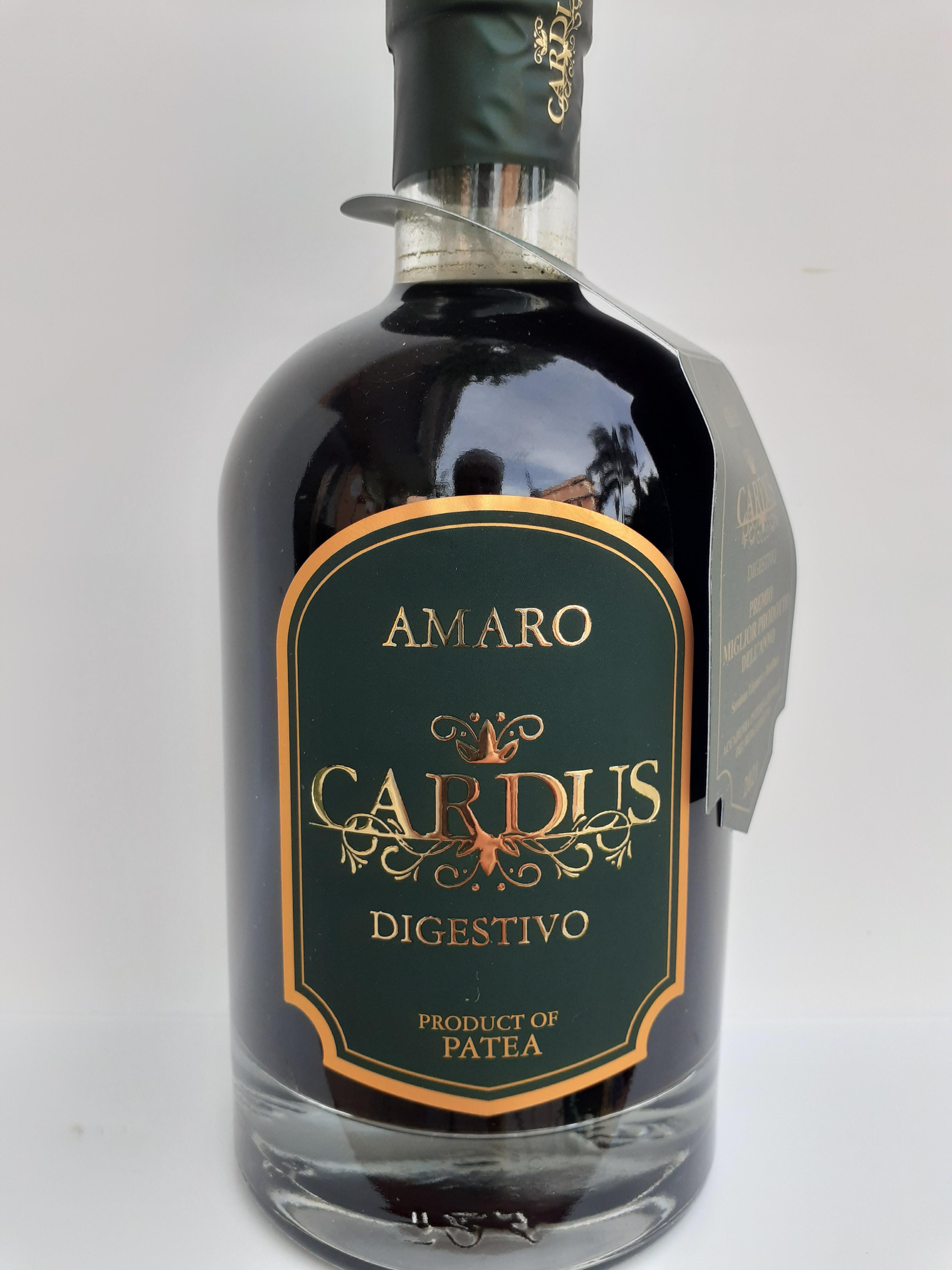 Amaro Cardus dell' Azienda Agricola Patea di Brancaleone (RC) 70cl , prodotto dall' infusione di Cardo Selvatico , Bergamotto di Reggio Calabria , Mirtillo e altri aromi naturali. Ottimo digestivo da servire freddo o ghiacciato. 70cl